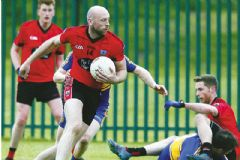 Clann win to stay top